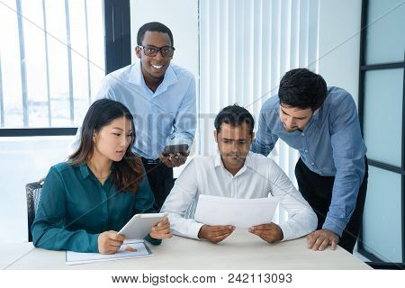 Business Group Presenting New Idea To Company Leader. Indian Businessman Reviewing Plan, Team Of Thr