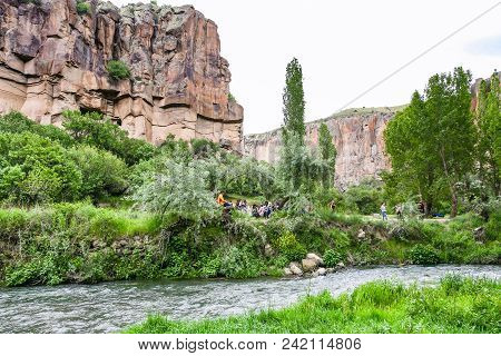 Ihlara Valley, Turkey - May 6, 2018: People On Beach Of Melendiz River In Ihlara Valley In Aksaray.