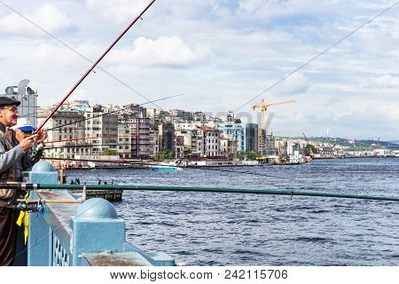 Istanbul, Turkey - May 11, 2018: Fishermen On Galata Bridge In Istanbul City. Istanbul Is The Most P