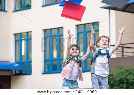 Happy Children - Two Boys Friends With Books And Backpacks On The First Or Last School Day.