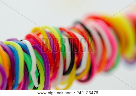 Various Colorful Plastic Tires Are On White Background. Selective Clarity,
