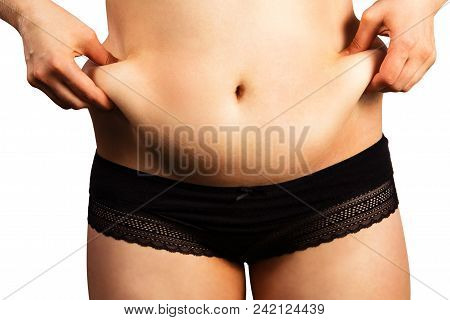 Body Of Young Woman With Excess Weight, Keeping Your Belly Fat, Isolated On White Background. Belly