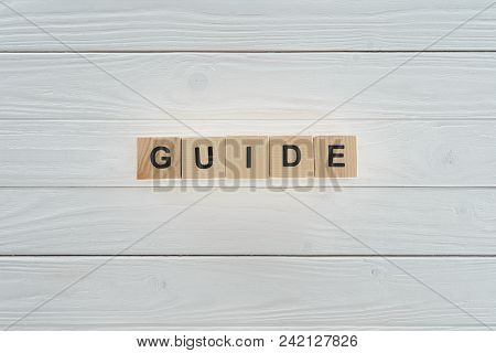 Top View Of Guide Word Made Of Wooden Blocks On White Wooden Surface