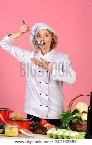 Female Chef Holds Spoon With Hot Food. Cooking And Professional Culinary Concept. Food Preparation C