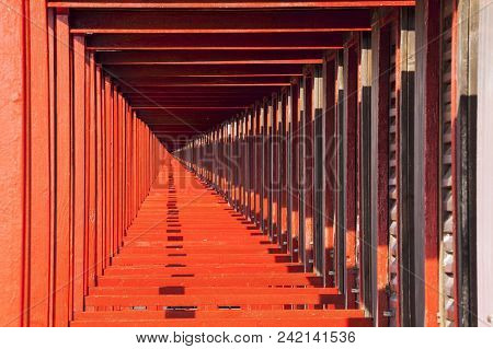 Perspective View Of The Red Beach Huts. Infinite Background. The Cabins On The Beach In Succession F