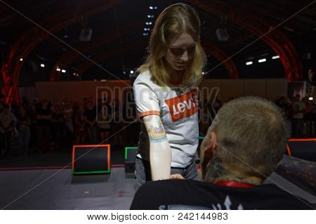 ST. PETERSBURG, RUSSIA - MAY 18, 2018: Unidentified tattoo model on the stage during Tattoo Show 2018. This year 3rd Convention of tattoo masters is held in Tattoo Show format
