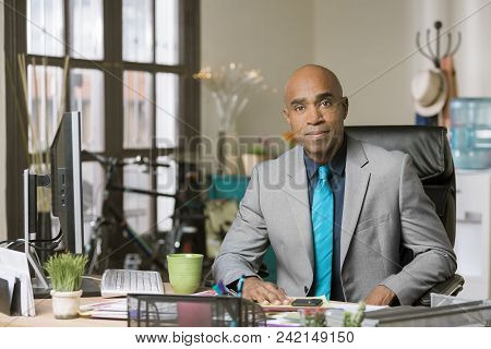 Stylish Professional Man Wearing A Tie In His Office