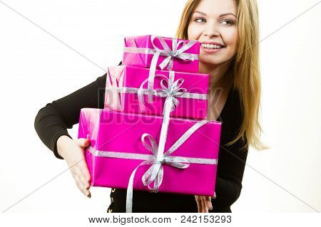 Happy Positivie Young Teenage Woman Holding Big Pile Of Pink Gift Boxes. Female Receiving Many Prese