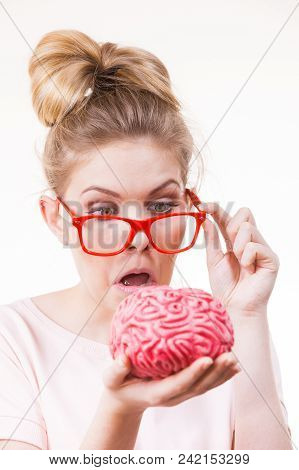 Funny Silly Weird Woman In Eyeglasses Holding Brain Having Something On Mind, Thinking Of New Concep