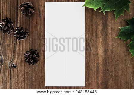 Blank Paper On Wooden Table With Decoration