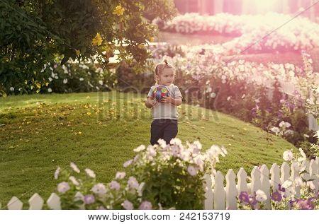 Child Childhood Children Happiness Concept. Baby Boy In Striped Tshirt, Shorts Outdoor. Kid In Garde