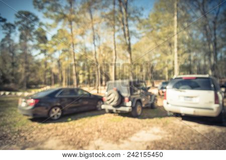 Vintage Blurred Parking Lots Near Forest Tall Live Oak Tree In Usa