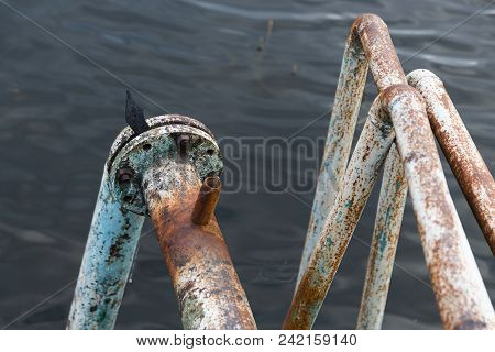 Iron Rusty Pipes Going Into The Depths Of The Lake