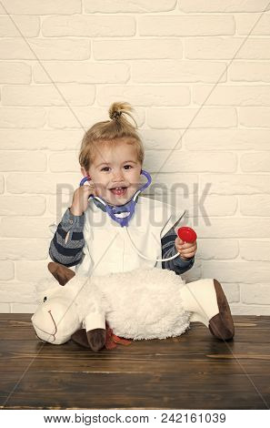 Child Childhood Children Happiness Concept. Happy Baby Veterinarian Examine Toy Animal With Stethosc