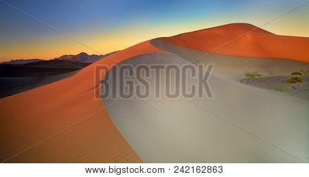 Desert Dreams: Sunrise Over Sand Dunes, Nevada
