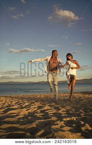Couple Secrets Fantasy. Man And Woman Hold Hands, Couple Happy On Vacation. Couple In Love Stand On