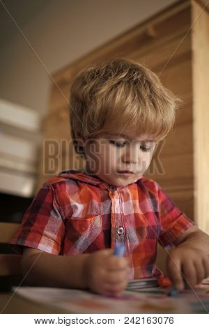 Child Childhood Children Happiness Concept. Education And Hobby. Small Boy Child Drawing With Colorf