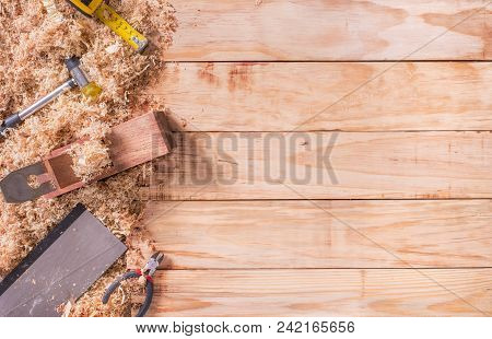 Set Of Carpenter Plane On Wooden Background With Copy Space.