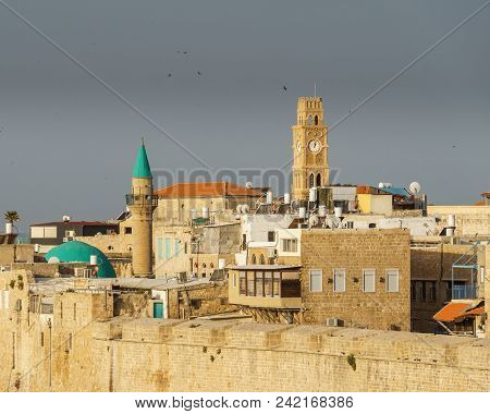 Acre, Israel - March 23, 2018: View Of The Old City Of Acre, With The Clock Tower, Minarets And Mosq