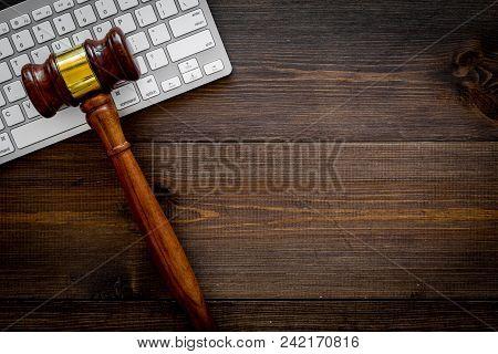 Work Desk Of Contemporary Lawyer. Lawyer Office Concept. Judge Gavel Near Computer Keyboard On Dark