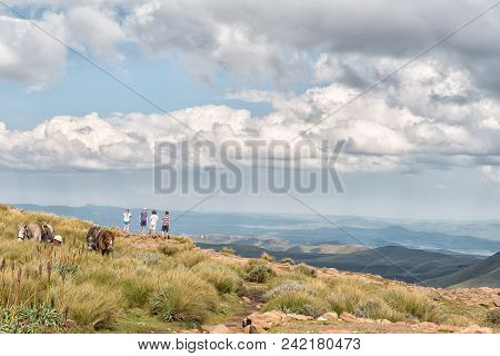 Sani Top, Lesotho - March 24, 2018: Unidentified Tourists On The Edge Of The Drakensberg Escarpment
