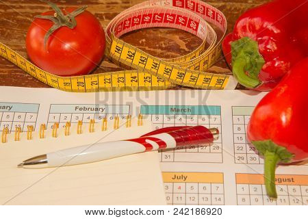 Fruits And Vitamins With Measuring Tape. Diet Plan. The Concept Of Weight Loss, Wellness And Healthy
