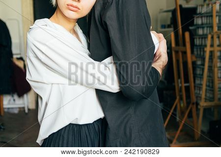 Holding Hands. Lovers Couple Holding Hands In A Room. Hand In Hand.hug