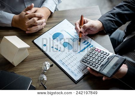 Real Estate Broker Agent Being Analysis And Making The Decision A Home Estate Loan To Customer, Agen