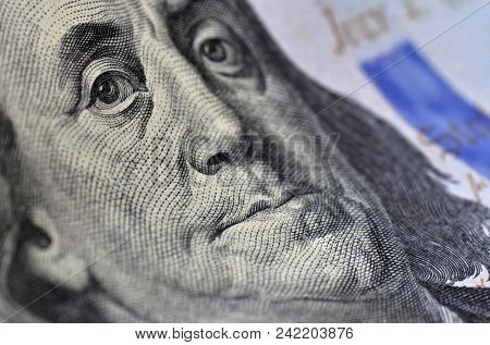 Benjamin Franklin from hundred dollars bill. Sharpness on the left eye and same side of his face. Macro image.