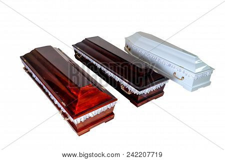 Three Closed Wooden Coffins Isolated On White Background