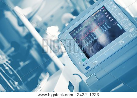 Ecg Waves And Roentgen Image Of Chest On The Life Support Monitor During Medical Doctors Save The Pa