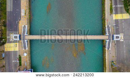 Top-down Drone View Of The Pedestrian Suspension Malyy Kubanskiy Bridge Over Sochi River, Russia