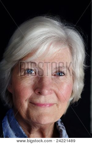 Senior lady portrait on black background