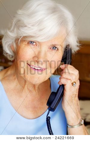 Senior lady having a telephone call