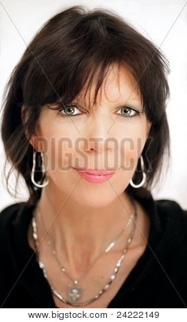 Mature woman portrait with black shirt and silver earring and necklace on white background