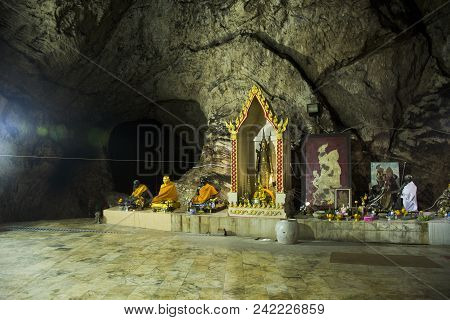 Many Buddha And God And Angel And Hermit Statue In Cave For Thai People Visit And Respect Or Praying