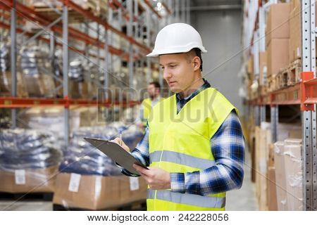 logistic business, shipment and people concept - male worker or supervisor with clipboard in reflective safety vest at warehouse poster