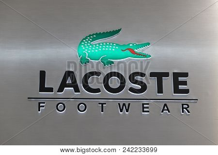 Manila, Philippines, 22 March 2018: Lacoste Brand Name On Storefront In Sm Mall Of Asia Shopping Mal