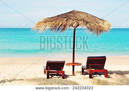 Close Up Of A Beautiful  Straw Umbrella ,isolated On The Beach At Daytime On The Empty Beach, Bright