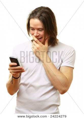 Amazed young man reading sms on his cellphone isolated on white