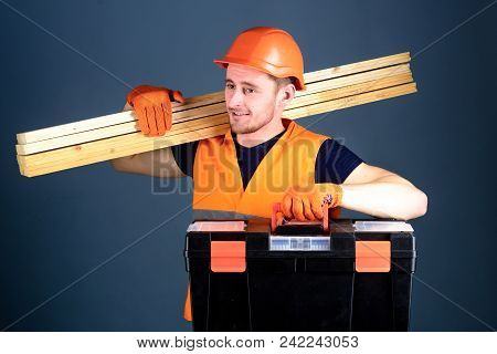 Professional Woodworker Concept. Carpenter, Labourer, Builder, Woodworker On Smiling Face Carries Wo