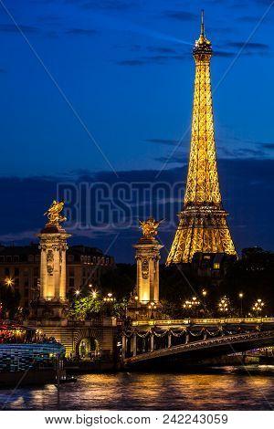 Paris, France - July 01, 2017: Beautiful Night Illumination Of Eiffel Tower And Pont Alexandre Iii B