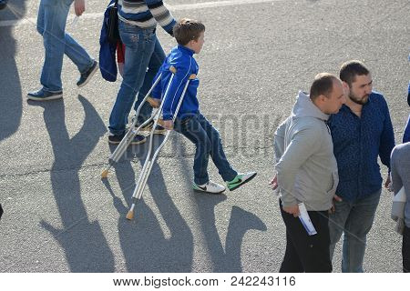 Minsk, Belarus - May 23, 2018: Little Fan On Crutches With A Leg Injury Before The Belarusian Premie