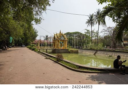 Siem Reap, Cambodia - 27 March 2018: Wat Damnak Pagoda Landscape With Pond And Shrine. Traditional B