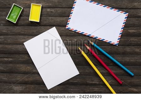 Blank Postcard And Art Supplies Flat Lay On Rustic Wooden Background. Art Supply In Summer Travel. P