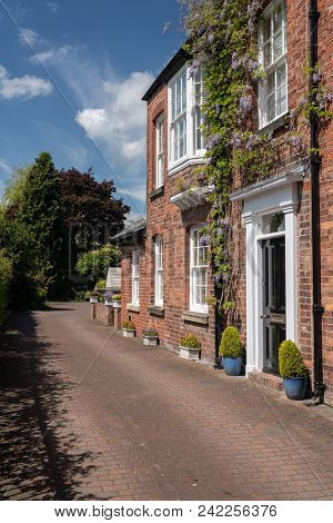 Oswestry, Shropshire, Uk - May 15, 2018: Exterior Of Brick Georgian Home By Town Park In Oswestry, S