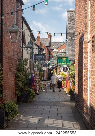 Oswestry, Shropshire, Uk - May 15, 2018: Shoppers In Narrow Alley Off English Walls In Oswestry, Shr