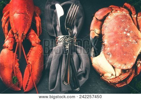 Fine Selection Of Crustacean For Dinner. Lobster And Crab On Dark Background
