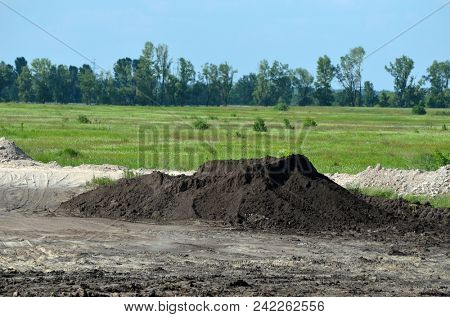 Stripping of a fertile layer of soil by bulldozer for sale. The land market in Ukrainian. May 25, 2018.Near Kiev, Ukraine
