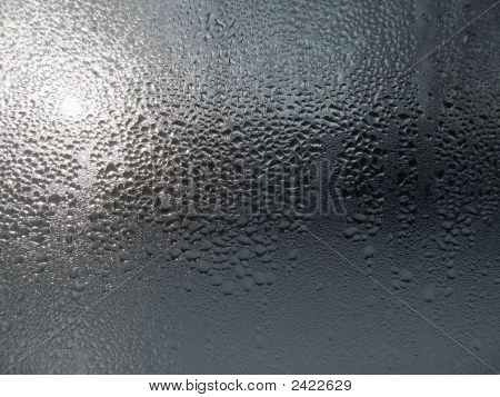 Close-up clear drops of water on window glass surface poster